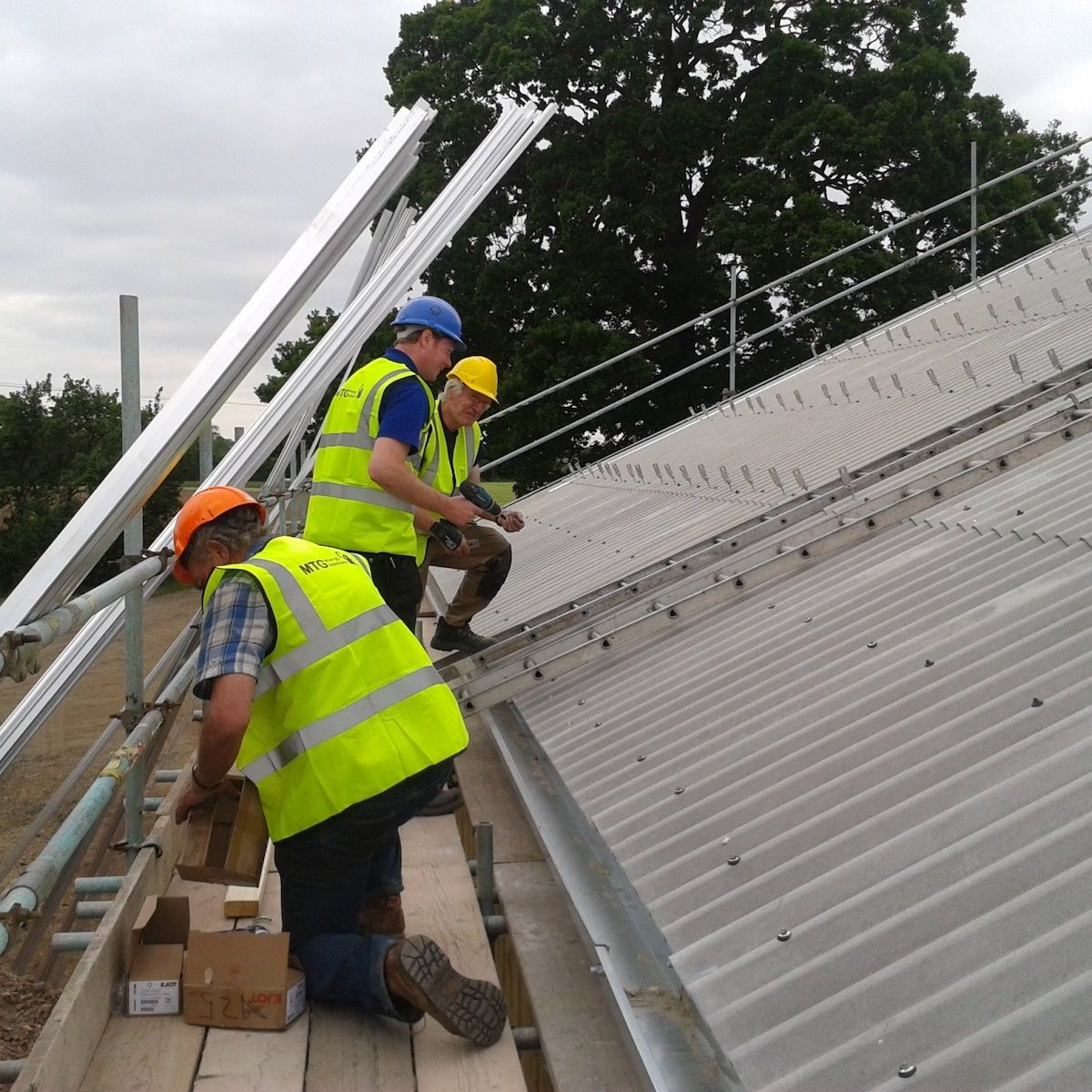 Three Installers on a roof